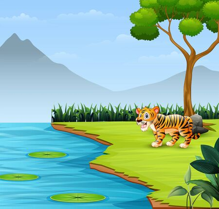 Cute baby tiger roars by the river