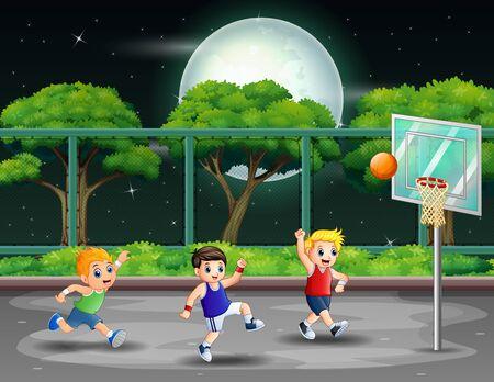 Muchachos felices jugando baloncesto en la cancha en la noche