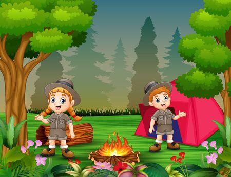 Boys and girls in camping outfit near bonfire and a tent Stock Photo