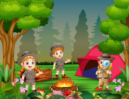 Happy children camping out in the beauful forest Stock Photo