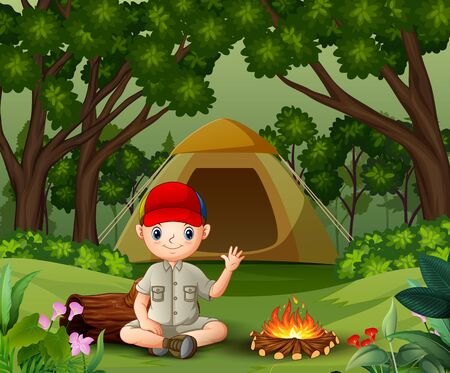 Boy scout sitting near the campfire