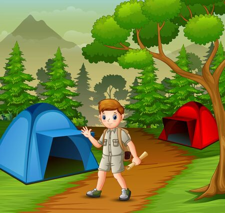 Boy in explorer outfit camping out in nature
