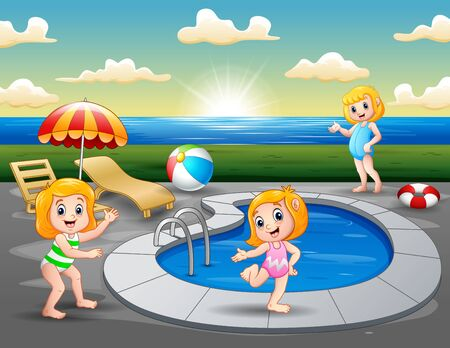 Children playing in outdoor swimming pool on the beach