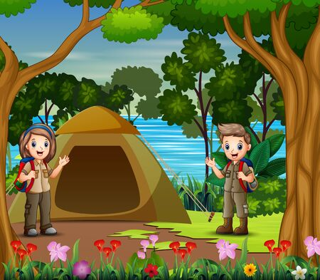 The scout boy and girl camping by the river