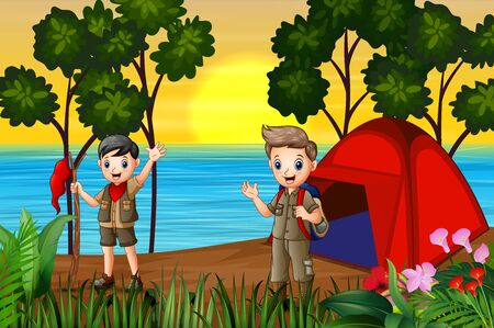 The scout boys camping by the lake at sunset