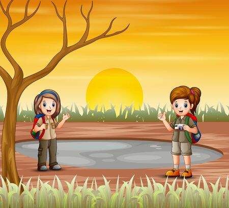 Two scout girls are exploring in dried land