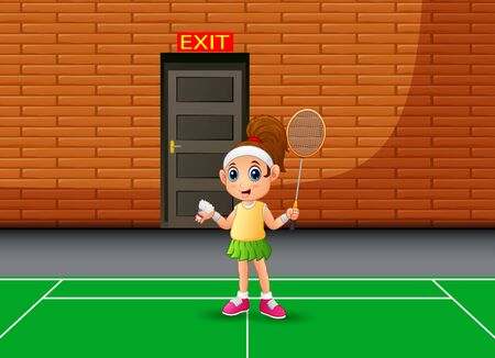 Happy boy playing badminton indoor