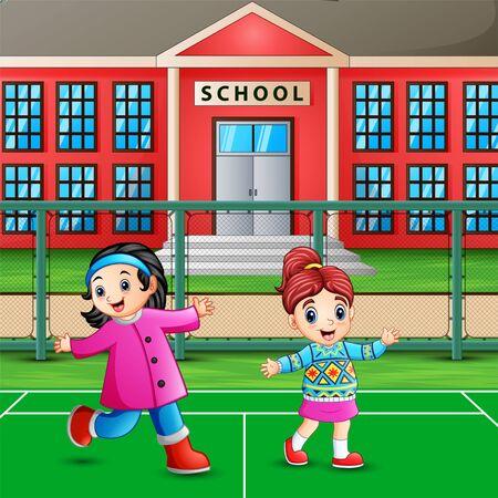 Happy little girls playing on school ground