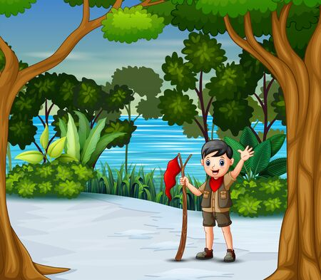 A scout boy with red flag in the winter forest
