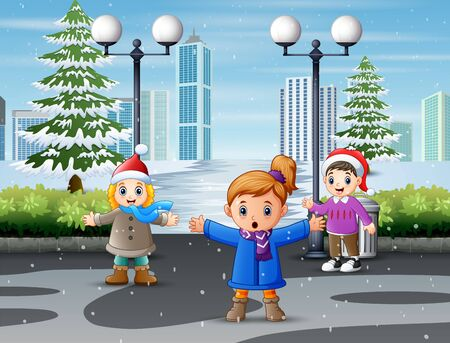 Children playing on a snow covered park