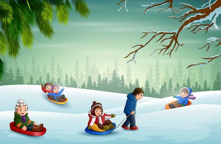 Happy children playing sledding in the snow
