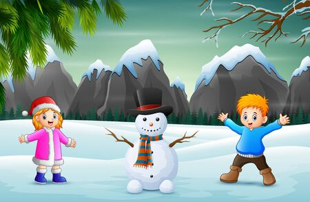 Children with snowman in snowy landscape