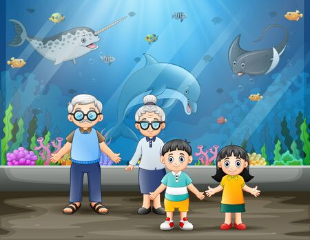 An elderly couple and their grandchildren looking at fishes