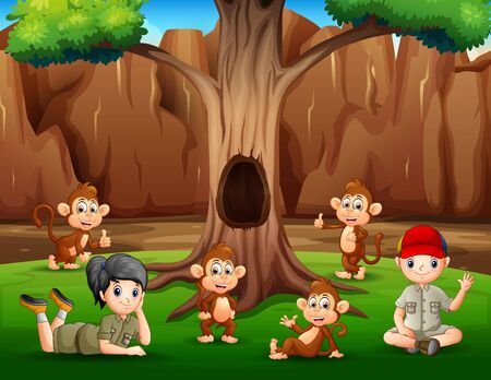 A boy and girl relaxing under tree with monkeys