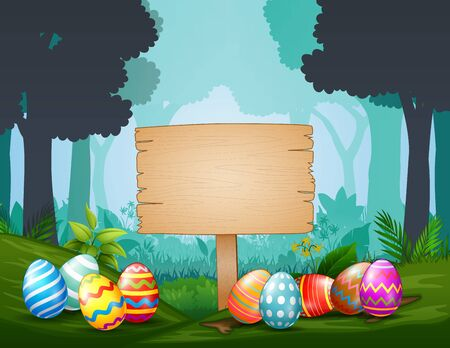 Easter eggs with wooden sign  in the middle of dark forest Stockfoto - 144940134