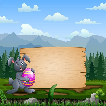 A bunny holding Easter Egg with blank wooden sign Stockfoto - 144940260
