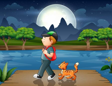 Boy with his cat walking on the pier