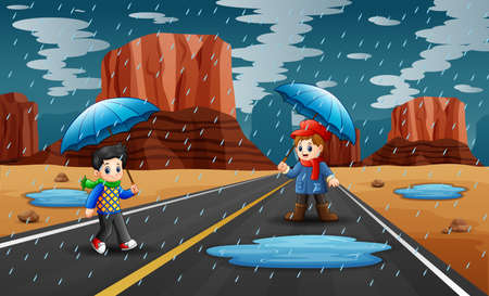 Happy boys holding umbrella in raining on the road