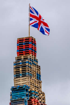 Union Jack adorns top of Loyalist bonfire in Belfast.