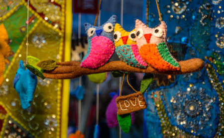 Cute Owl Toys On Their Perch Banque d'images