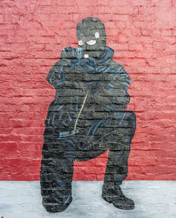 gunman: UVF Kneeled Gunman From East Mural. Editorial