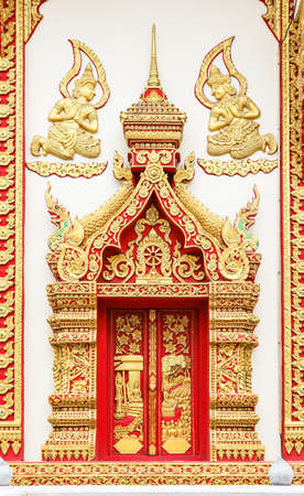 Stucco pattern on the wall of temple and have Buddha image in the middle at temple in Thailand.