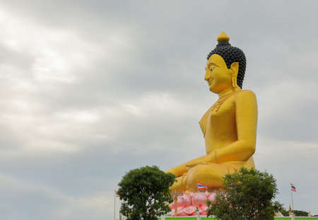 Sculpture about golden Buddha image is Buddha posture sit on pink lotus  base and feel happy.