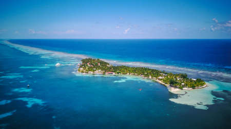 Aerial Drone view of South Water Caye tropical island in Belize barrier reef. A typical Caribbean island with turquoise water Imagens