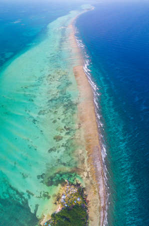 Aerial view of tropical island at Glovers Reef Atoll in Belize Barrier Reef
