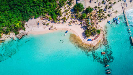 Aerial drone view of Saona Island in Punta Cana, Dominican Republic with reef, trees and beach in a tropical landscape with boats and vegetation