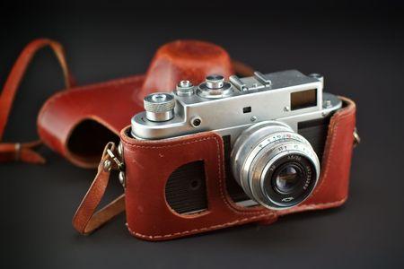 rangefinder: vintage soviet rangefinder camera in a leather bag on a black background Stock Photo