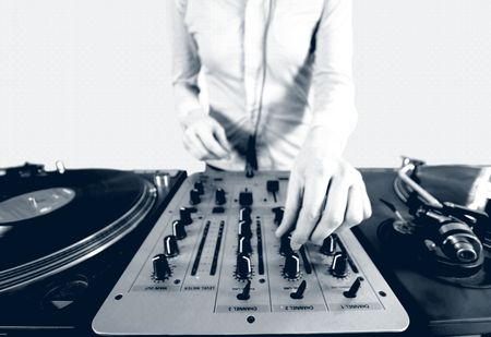 black and white halftone image of a funky female dj, mixing on turntables