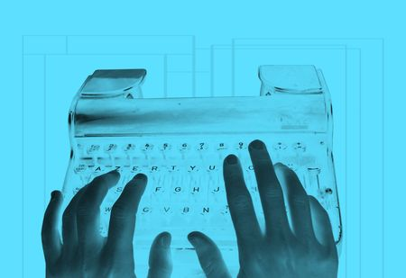 transcribe: An inverted image of hands typing on an old-fashioned retro typewriter Stock Photo
