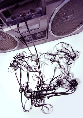 spewing: cassette tape spewing out of a retro ghettoblaster