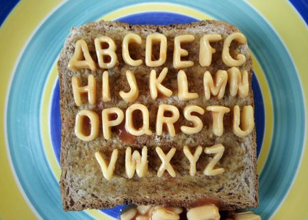 huh: the alphabet made from spaghetti pasta shapes - wide angle, funny huh! Stock Photo