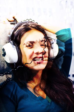 sound bite: beautiful young woman listening to music and biting headphone coil