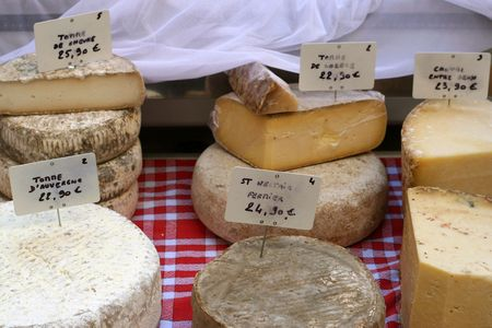 selection of local cheeses in french market Stock Photo