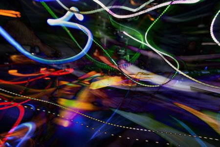 dj mixing at a club, with abstract trails of light Stock Photo
