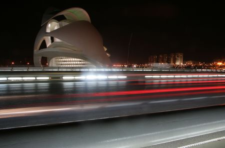the futuristic looking science centre in valencia, spain at night with traffic rush
