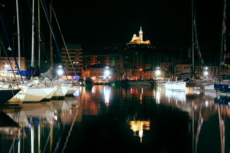 notre dame and boat reflections at night in marseille vieux port Stock Photo - 969334