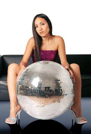 young woman on a sofa with a large discoball