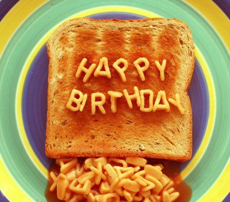 happy birthday written with alphabetti spaghetti pasta shapes on toast photo