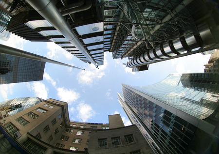 lloyd's: fisheye of swiss re and lloyds buildings in london with sky