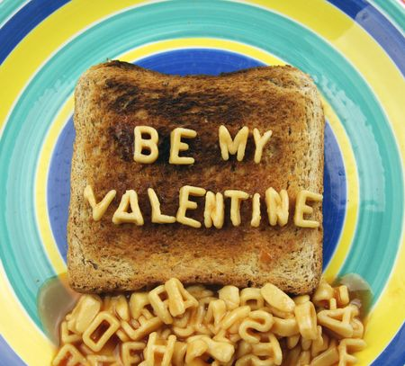 the words be my valentine, spelled out with spaghetti letters photo