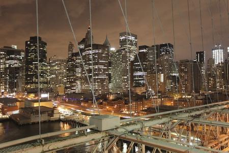 iconic: shot of lower manhattan from brooklyn bridge at night Stock Photo