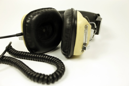 retro headphones shot against white photo