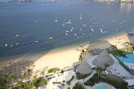 huge bay of hotels stretching along the coast in acapulco, mexico