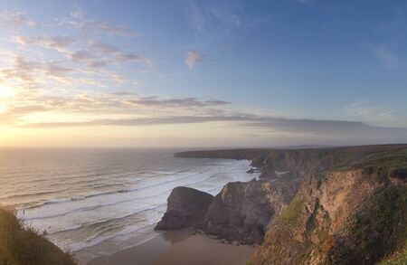 the stunning coastline at bedruthan steps at sunset on the north cornwall coast, england photo