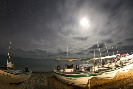 stargaze: stars at night of the ocean and boats in baja california sur, mexico Editorial