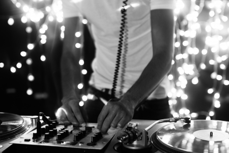 deejay: a cool male dj on the turntables Stock Photo